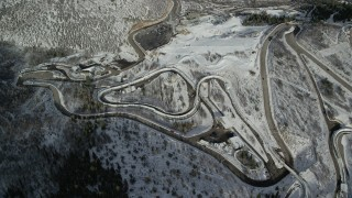 AX126_104 - 6K stock footage aerial video of circling the tracks for luge and bobsled events at Utah Olympic Park with winter snow, Park City
