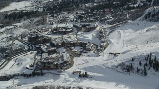 AX126_110 - 6K stock footage aerial video orbit Canyons Resort in Park City with winter snow in Utah