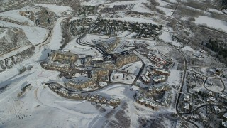 AX126_114 - 6K stock footage aerial video orbiting hotels at Canyons Resort in Park City in wintertime, Utah