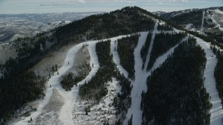 AX126_117 - 6K stock footage aerial video orbit ski lifts on Iron Mountain at the Canyons Resort in Park City, Utah
