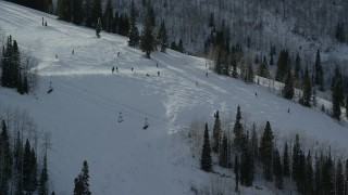 AX126_128 - 6K stock footage aerial video of circling skiers on a slope at Park City Mountain Resort in winter, Utah