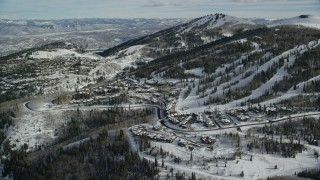 AX126_129 - 6K stock footage aerial video approach the ski runs on snowy slopes at Deer Valley in Park City, Utah