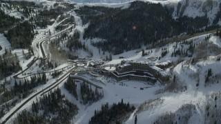 AX126_130 - 6K stock footage aerial video orbit Montage Deer Valley Hotel near ski runs in Park City, Utah