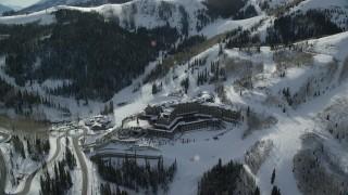 AX126_131 - 6K stock footage aerial video orbit of Montage Deer Valley Hotel in wintery Park City, Utah