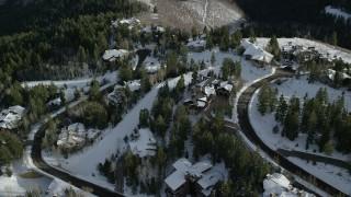 AX126_143 - 6K stock footage aerial video orbit spacious mountaintop mansions with winter snow in Deer Valley, Utah