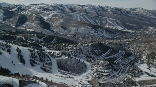 AX126_147 - 6K stock footage aerial video orbit neighborhood on and around snowy hill in Park City, Utah