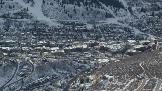 AX126_148 - 6K stock footage aerial video flyby the center of the small town of Park City in winter, Utah