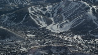 AX126_155 - 6K stock footage aerial video of small mountain town beside ski slopes in winter, Park City, Utah