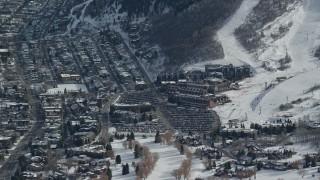 AX126_161 - 6K stock footage aerial video of hotels below ski runs at a winter resort in Utah's Park City