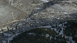 AX126_168 - 6K stock footage aerial video of small snowy mountain town in wintertime, Park City, Utah