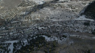 AX126_169 - 6K stock footage aerial video of Park City with winter snow seen from a mountain slope, Utah