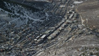 AX126_173 - 6K stock footage aerial video of circling the town center of Park City with winter snow, Utah