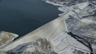 AX126_185 - 6K stock footage aerial video orbit of the Jordanelle Dam near Heber City in winter, Utah