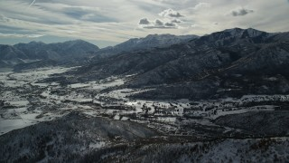 AX126_199 - 6K stock footage aerial video approach the small town of Midway with winter snow in Utah