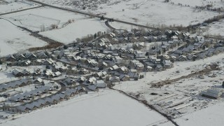 AX126_202 - 6K stock footage aerial video orbit tract homes in a small town neighborhood in Midway, Utah