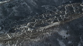 AX126_203 - 6K stock footage aerial video approach rural small town homes with winter snow in Midway, Utah