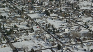 AX126_209 - 6K stock footage aerial video fly over a small town neighborhood with snow on the ground in Midway, Utah