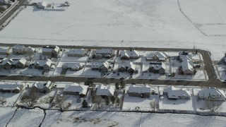AX126_211 - 6K stock footage aerial video orbit rows of tract homes with winter snow on rooftops in Midway, Utah