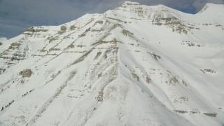 AX126_262 - 6K stock footage aerial video orbit snowy slopes of giant Mount Timpanogos in Utah