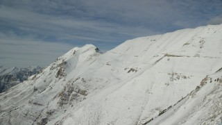 AX126_265 - 6K stock footage aerial video of steep slopes with winter snow on Mount Timpanogos, Utah