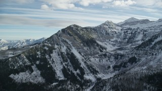AX126_277 - 6K stock footage aerial video of Mount Timpanogos with snowy slopes in wintertime, Utah