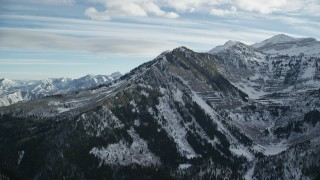 AX126_278 - 6K stock footage aerial video of north end slopes of snowy Mount Timpanogos in winter, Utah