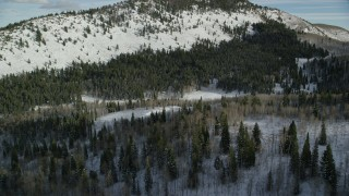 AX126_287 - 6K stock footage aerial video of flying over evergreen forest with winter snow in Utah's Wasatch Range