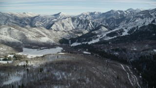 AX126_295 - 6K stock footage aerial video approach Sundance Mountain Resort and distant snow mountains in Utah