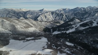 AX126_296 - 6K stock footage aerial video approach distant snow mountains while flying over Sundance, Utah