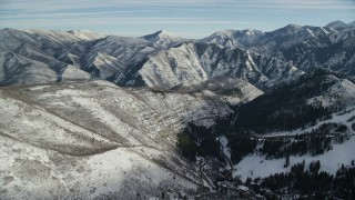 AX126_298 - 6K stock footage aerial video fly over Sundance Resort and approach Wasatch Range mountains with light snow, Utah