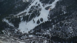 AX126_299 - 6K stock footage aerial video orbit ski lifts and runs at the Sundance Mountain Resort with winter snow in Utah