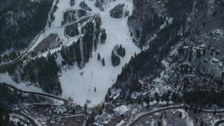AX126_300 - 6K stock footage video orbit runs and lifts at Sundance Mountain Ski Resort with winter snow, Utah
