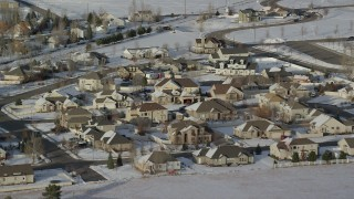 AX127_003 - 6K stock footage aerial video of tract homes with winter snow in a small town, Heber City, Utah