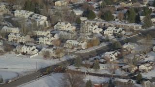 AX127_006 - 6K stock footage aerial video orbit duplex homes with winter snow in Heber City, Utah