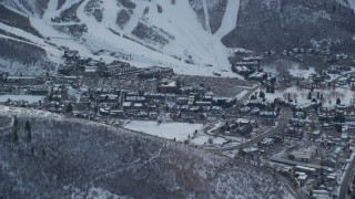 AX127_023 - 6K stock footage aerial video of center of town in Park City with light winter snow at sunset, Utah