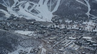 AX127_024 - 6K stock footage aerial video of Park City's town center with winter snow at sunset, Utah
