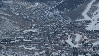 AX127_030 - 6K stock footage aerial video of circling Park City with winter snow at sunset, Utah