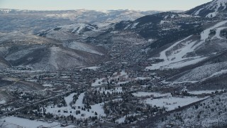 AX127_032 - 6K stock footage aerial video of orbiting Park City at sunset with light winter snow, Utah