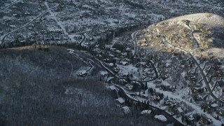 AX127_039 - 6K stock footage aerial video approach hillside homes with winter snow at sunset, Park City, Utah