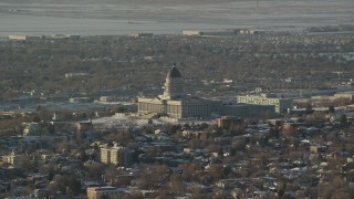 AX127_083 - 6K stock footage aerial video of Utah State Capitol with snow on the ground at sunset, Salt Lake City