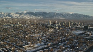 AX127_093 - 6K stock footage aerial video orbit of the Utah State Capitol and Downtown Salt Lake City with winter snow at sunset
