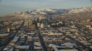 AX127_133 - 6K stock footage aerial video approach Main and State Streets through Downtown Salt Lake City, Utah, sunset in winter