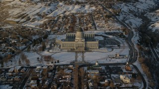 AX127_140 - 6K stock footage aerial video approach Utah State Capitol Building at sunset with winter snow, Salt Lake City