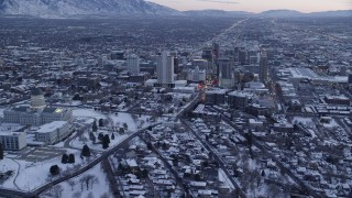 AX128_007 - 6K stock footage aerial video orbit Downtown Salt Lake City and reveal the state capitol with winter snow at twilight, Utah