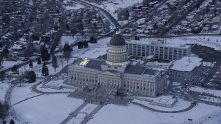 AX128_010 - 6K stock footage aerial video orbit front of Utah State Capitol with winter snow at twilight, Salt Lake City