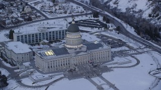 AX128_011 - 6K stock footage aerial video orbit front side of Utah State Capitol with winter snow on the ground at twilight, Salt Lake City
