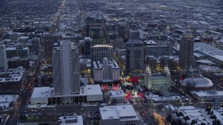 AX128_024 - 6K stock footage aerial video fly over Salt Lake Temple in Downtown SLC and approach Main Street in winter at twilight, Utah