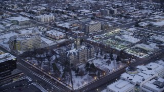 AX128_027 - 6K stock footage aerial video orbit Salt Lake City Hall with winter snow at twilight, Utah