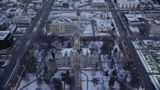 AX128_028 - 6K stock footage aerial video orbit city hall in Downtown Salt Lake City with winter snow at sunset, Utah