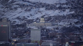 AX128_035 - 6K stock footage aerial video orbit Utah Capitol Building with winter snow seen from Downtown Salt Lake City at twilight